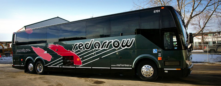 Sideview of a Red Arrow black motorcoach