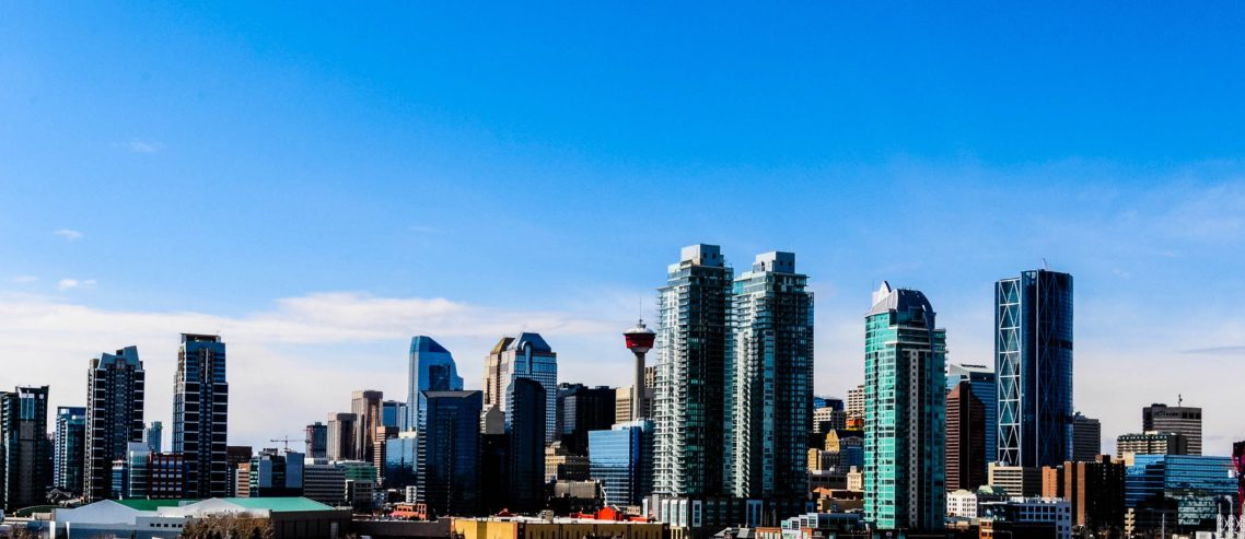 Calgary city skyline under blue sky during daytime